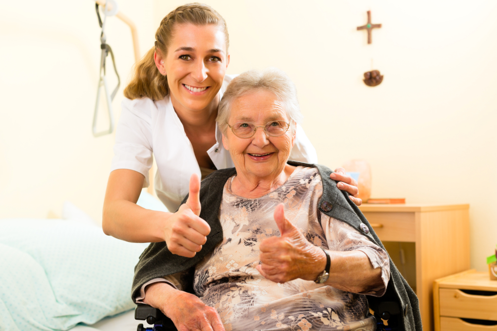 Nurse and an elderly doing a thumbs-up sign